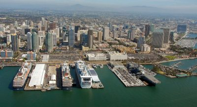 From left to right are Holland America's Westerdam and Zuiderdam, and Princess Cruises Grand Princess. On the right is the USS Midway.